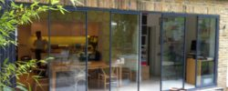spaced slide-swing-stack doors